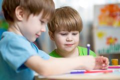 Kids boys painting in nursery at home Royalty Free Stock Images