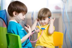 Kids boys play doctor at home Stock Images
