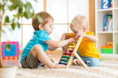 Kids boys playing with abacus Royalty Free Stock Photography