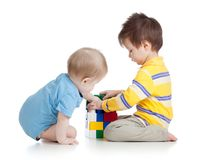 Kids boys playing with toys together. Isolated on white background royalty free stock photo