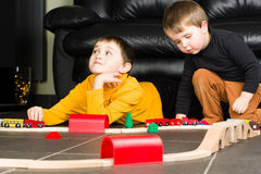 Kids boys playing with wooden trains Stock Photography