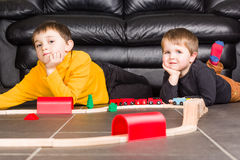 Kids boys playing with wooden trains Royalty Free Stock Photo