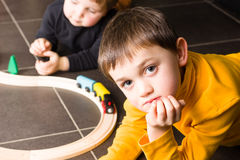 Kids boys playing with wooden trains Royalty Free Stock Photography