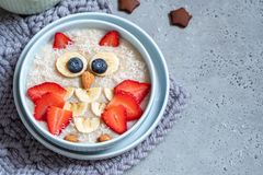 Kids breakfast oatmeal porridge with berries and nuts stock photos