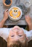 Kids breakfast oatmeal porridge with fruit stock photos