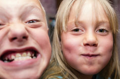 Kids, brother and sister, are posing faces Royalty Free Stock Photo