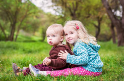 Kids brother and sister sitting Stock Photography
