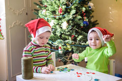 Kids brothers child boys making by hands x-mas decorations royalty free stock images