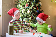 Kids brothers child boys making by hands x-mas decorations royalty free stock image