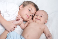 Kids brothers lying on floor st home Royalty Free Stock Photography