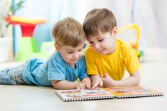 Kids Brothers Read A Book At Home Stock Images
