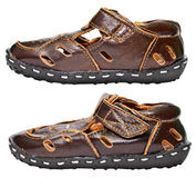 Kids brown leather sandals on white Royalty Free Stock Photography