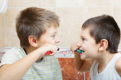 Kids brushing teeth Stock Images