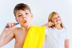 Kids brushing teeth Royalty Free Stock Images
