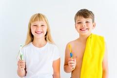 Kids brushing teeth Stock Images