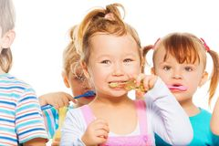 Kids brushing their teeth Royalty Free Stock Image