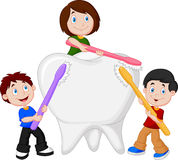 Kids brushing white tooth Stock Photos