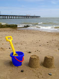 Kids bucket, spade and sandcastles, Felixstowe. Stock Photo