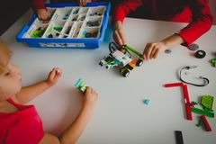 Kids building robot at robotic technology school lesson. Education stock image