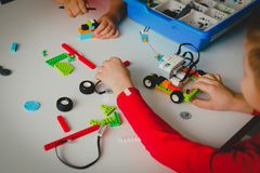 Kids building robot at robotic technology school lesson. Education stock photo