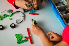 Kids building robot at robotic technology school lesson. Education royalty free stock photos