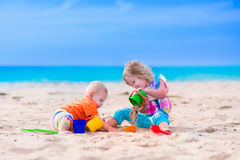 Kids building a sand castle on a beach Royalty Free Stock Photo