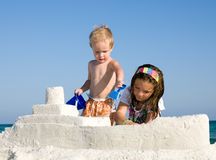 Kids Building Sandcastle on a Beach Stock Image