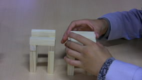 Kids building tower from toy blocks stock footage