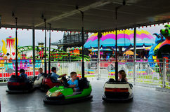 Kids and bumper cars at the county fair Stock Photo