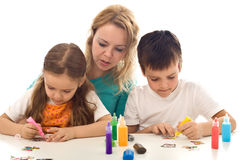 Kids busy painting with lots of colors Royalty Free Stock Image