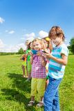 Kids busy with phones Royalty Free Stock Image