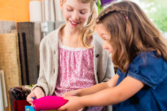 Kids buying supplies  in handicraft store Stock Image