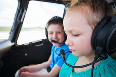 Kids at cabin of helicopter Stock Photo