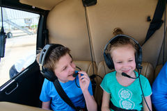 Kids at cabin of helicopter Royalty Free Stock Photos