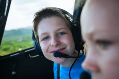 Kids at cabin of helicopter Royalty Free Stock Image
