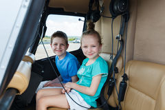 Kids at cabin of helicopter Royalty Free Stock Photo