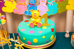 Kids cake on birthday. 1st year kids birthday cake with sweet bear on the top and number one sign stock photos