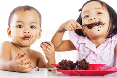 Kids With Cake. Two kids feasting a plate of chocolate cake stock photography