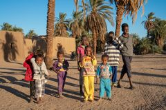 Curious Nubian children posing for a picture in Abri, Sudan - Dec 2018 royalty free stock photography