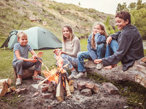 Kids in the camp by the fire stock photos