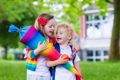 Kids with candy cone on first school day in Germany Stock Photos