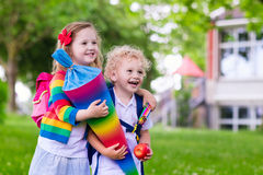 Kids with candy cone on first school day in Germany Stock Image