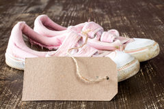 Kids canvas shoes with blank tag Royalty Free Stock Images