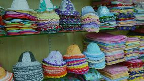Kids cap, kids clothing and toy store. Modern clothes for babies and children on display in children shop. Shelves with colorful