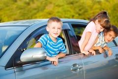 Kids in car stock photo