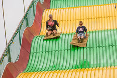 Kids on carnival slide at state fair Royalty Free Stock Images