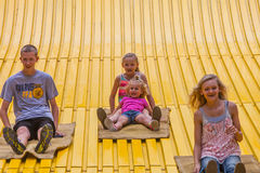 Kids on carnival slide at state fair Stock Photo