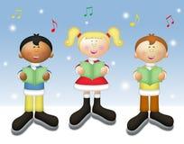 Kids Caroling. Three kids singing Christmas carols in winter setting Royalty Free Stock Photos