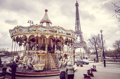 Kids at the carousel of the Eiffel Tower in Paris royalty free stock image