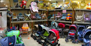Kids Carriages in kids shop Royalty Free Stock Image